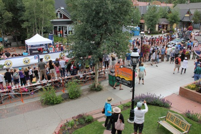 The USA Pro Cycling Challendge rolls along Main Street in front of Breckenridge Associates