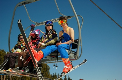 Warm weather for Spring Break, shot of skiers dressed for spring riding the lift at Breckenridge Ski Resort