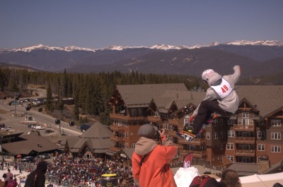 Spring ski festival, picture of competitors in the terrain park and the base area in the background